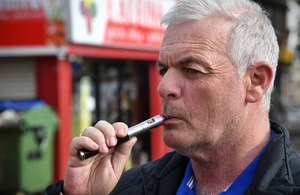 A man using an e-cigarette.