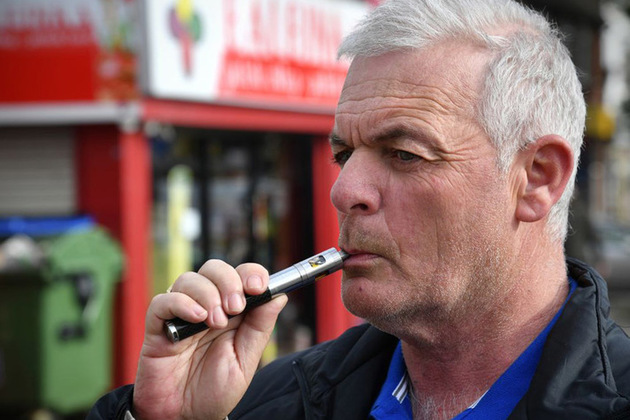 A man using an e-cigarette.