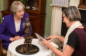 PM Theresa May with Dr Helen Pankhurst at the Pankhurst Centre in Manchester.