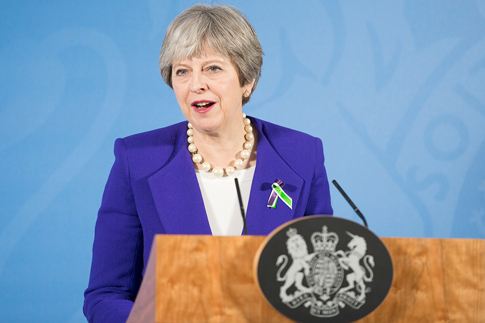 PM Theresa May speaking in Manchester.