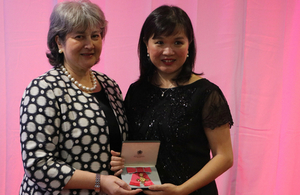 Professor Teo Soo-Hwang recieveing her Order of the British Empire OBE