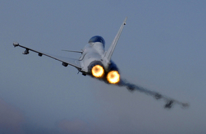 A Typhoon F2 fighter jet pilot applies the throttle as the aircraft pulls away from RAF Coningsby MOD