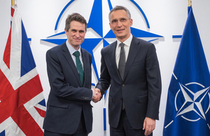 Gavin Williamson (UK Secretary of State for Defence) shaking hands with NATO Secretary General Jens Stoltenberg at NATO Headquarters in Brussels. Crown copyright.