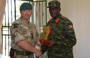 Royal Naval Officer with Ugandan Marine Commander