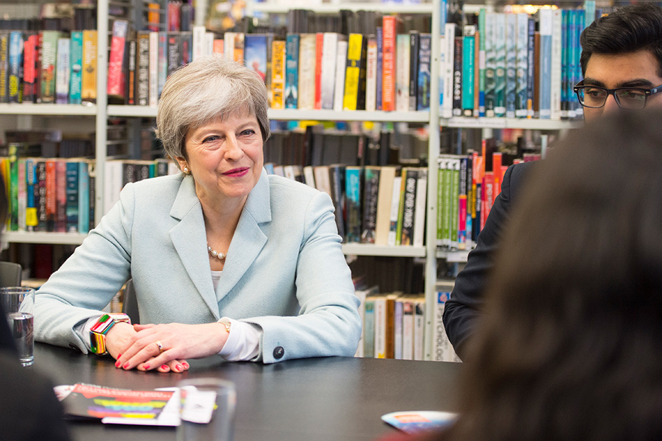 PM Theresa May meets schoolchildren on a day of visits as she launches a review into post-18 education and funding.