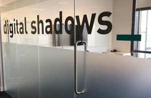 Glass door with Digital Shadows logo.