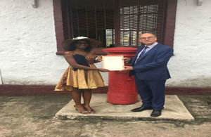 Noela Lyonga receives Commonwealth Points of Light certificate from British High Commissioner to Cameroon, H.E. Rowan Laxton.