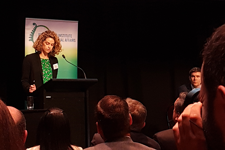 Laura Clarke presenting her speech at the NZIIA