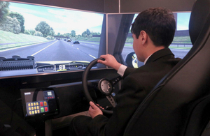 Image showing visitor using the Highways England simulator