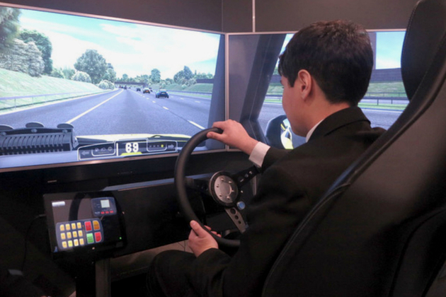 Image showing visitor using the Highways England simulator