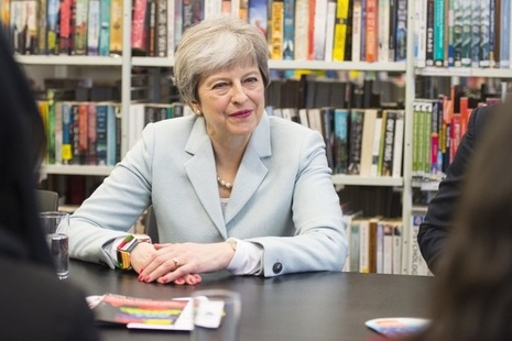 Prime Minister Theresa May in conversation with unseen participants