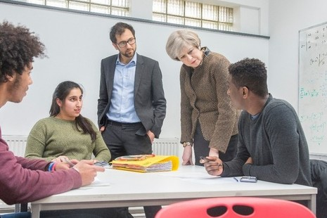 Prime Minister Theresa May talking to a group of young people