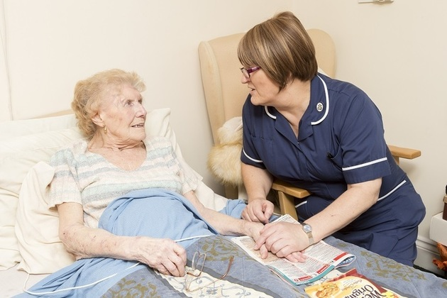 nurse speaking to elderly woman