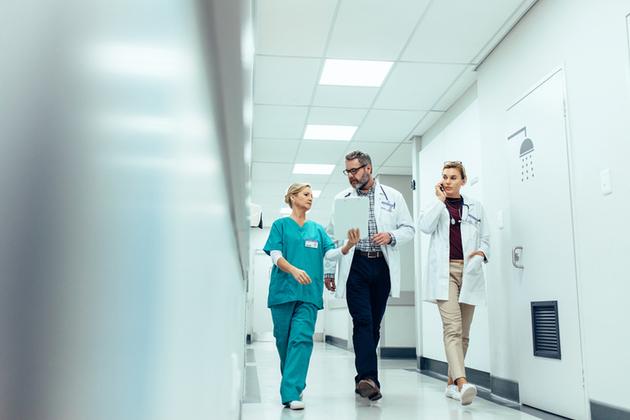 Medical professionals in a hospital corridor