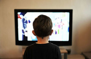 A young boy watching television.