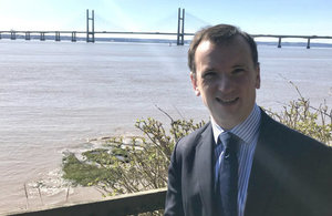 Welsh Secretary Alun Cairns next to the second Severn bridge, due to be renamed The Prince of Wales Bridge