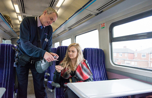 Picture of rail inspector with passenger.