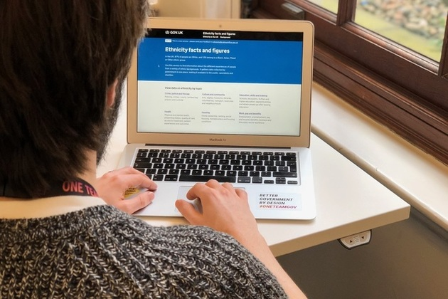 a person browsing the Ethnicity facts and figures website on a laptop
