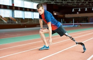 Boy on running track with prosthetic leg