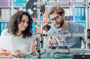Engineering students use a 3D printer in a lab via Stokkete at Shutterstock