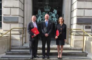 Pictured: Dr. Liam Fox, John Mahon, Baroness Rona Fairhead