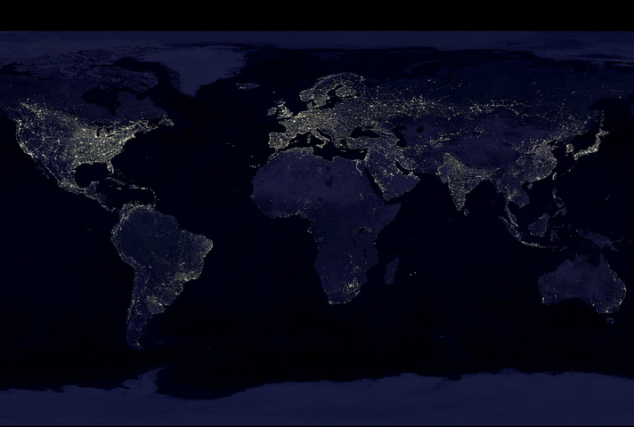 Composite image showing a global view of Earth at night, compiled from over 400 satellite images (credit: NASA/NOAA).