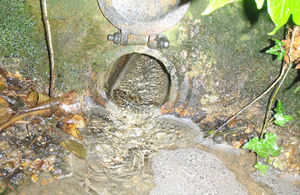 Pollutants entered the river from an outfall pipe