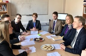 Damian Hinds with teachers around a table