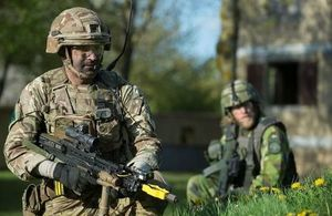 Image shows British and Swedish soldiers working with each other rehearsing for the Joint Expeditionary Force Demonstration as part of Exercise Joint Warrior in Copehill Down, Salisbury Plain Training Area.