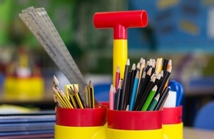 Pencils and pens in colourful holder