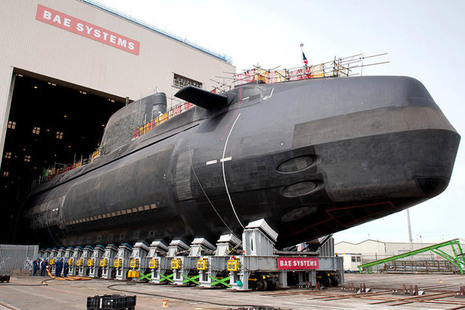 Britain's third Astute Class nuclear submarine, Artful, being lowered into the water at Barrow-in-Furness. Crown copyright.