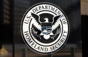 Department of Homeland Security seal at the US Immigration and Customs Enforcement Headquarters via Mark Van Scyoc at Shutterstock