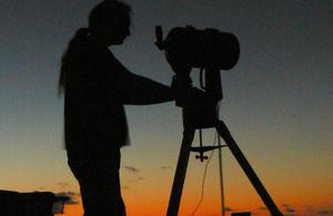 Astronomer at night
