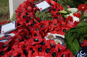 Wreaths lay below the newly engraved headstone, Crown copyright, All rights reserved