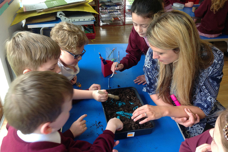 Children learning about Stonehenge archeology