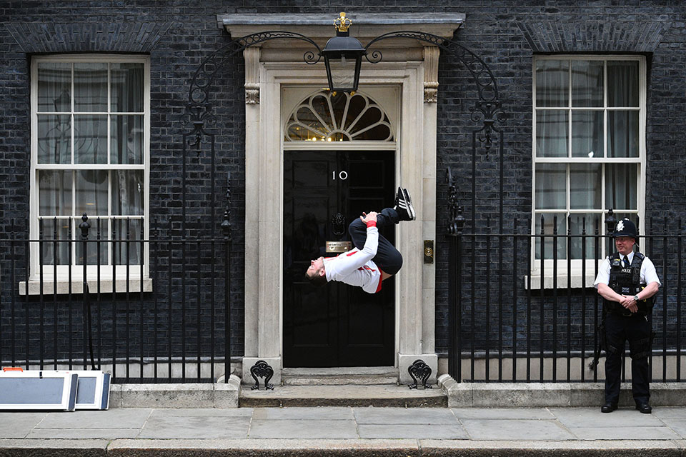 Gymnast back flips into the Commonwealth Games reception