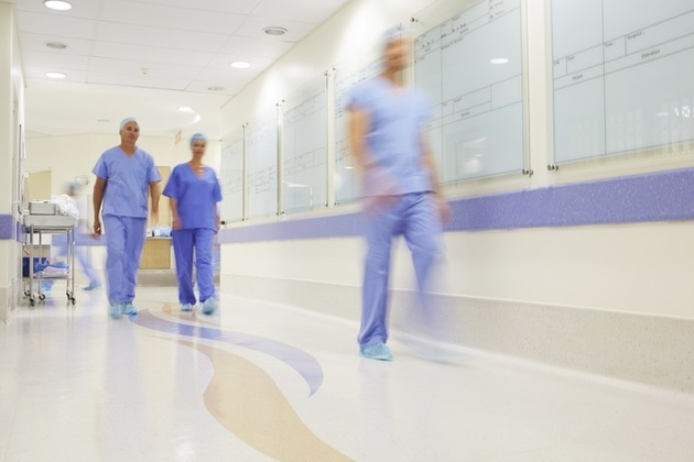 Doctors walking along a hospital corridor