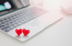 image of two hearts on top of a laptop