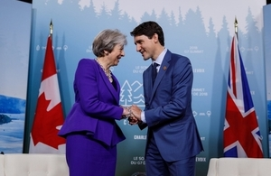 PM May with PM Trudeau Shaking Hands