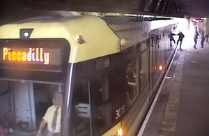 Platform CCTV image showing passenger with hand trapped in door (courtesy of Keolis Amey Metrolink)