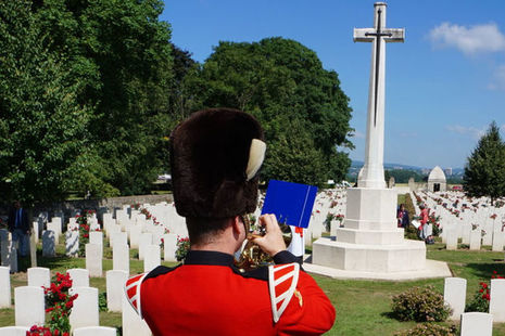 During the service a bugler plays in front of the cross. Crown Copyright. All rights reserved