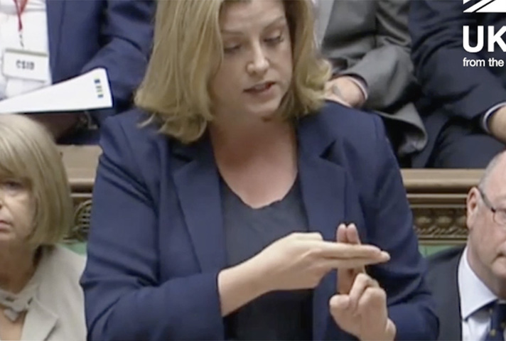 Penny Mordaunt using sign language in Parliament