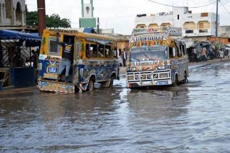 Buses drive through a flooded street in Dakar, Senegal. Picture: BRACED