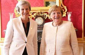 Theresa May and Angela Merkel at the Western Balkans Summit London