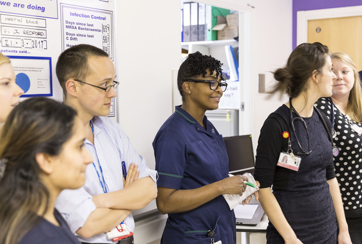 Nurses and doctors in hospital corridor