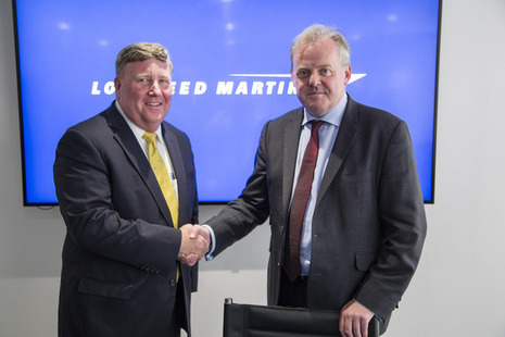 Defence Minister Guto Webb shaking hands with Lockheed Martin Vice President