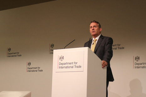 International Trade Secretary Dr Liam Fox MP speaking at a podium.