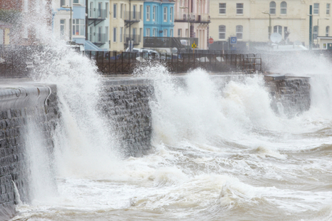 Waves crashing against a sea wall