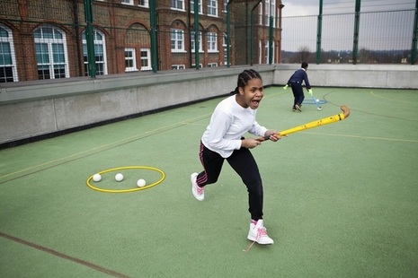 girl playing hockey