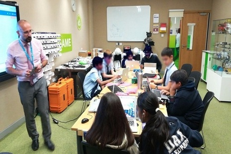 Picture of students using ScienceScope technology to learn about the Internet of things in on-site lab.